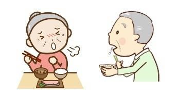 食事中にむせる高齢女性と食べこぼす高齢男性